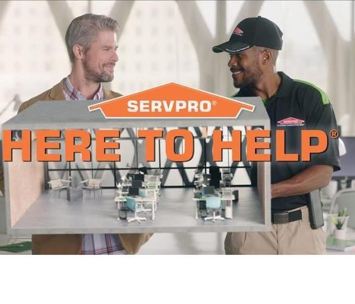 SERVPRO specialist discussing the customer's cleaning needs.