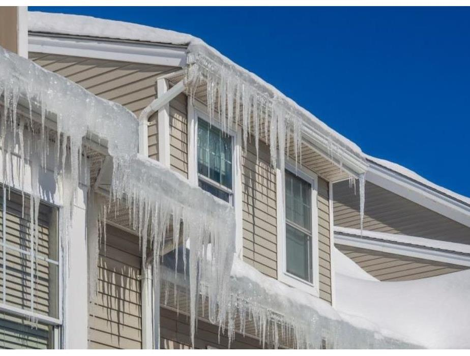 Numerous ice dams formed on the edge on a roof