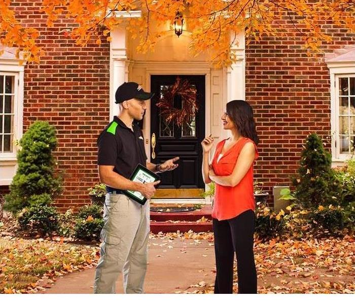 SERVPRO representative speaking to home owner about fire safety